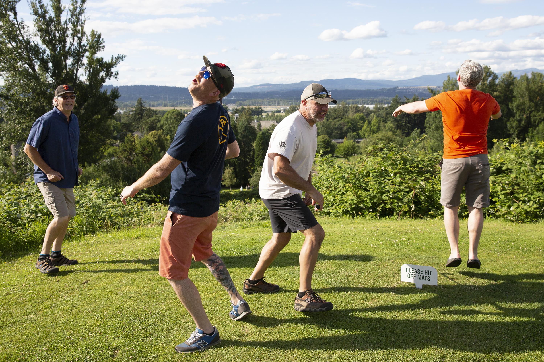 Golf group reacting to shot