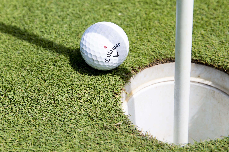 golf ball near hole